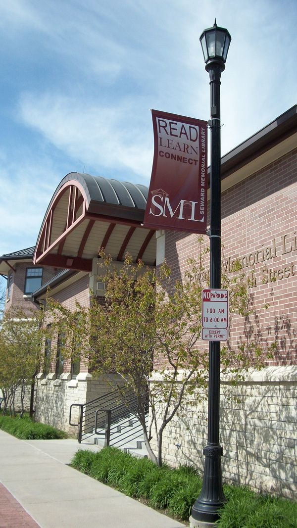 Light pole banner and stairs on the east entrance of the Seward Memorial Library